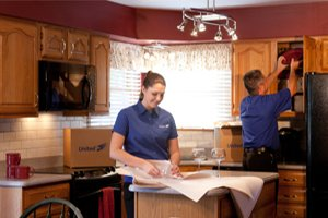 Residential Movers Assisting With Packing