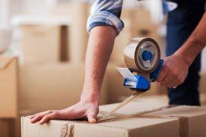 Sealing cardboard moving boxes